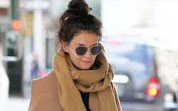 Actress Katie Holmes returns home after