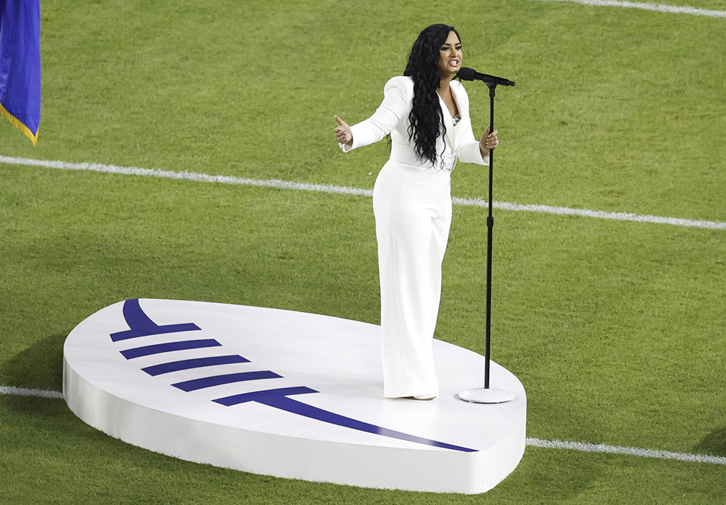 demi lovato, white jumpsuit, super bowl, US singer Demi Lovato performs the US National anthem before the start of the AFC Champion Kansas City Chiefs and the NFC Champion San Francisco 49ers game during the National Football League's Super Bowl LIV at Hard Rock Stadium in Miami Gardens, Florida, USA, 02 February 2020.Super Bowl LIV, Miami Gardens, USA - 02 Feb 2020