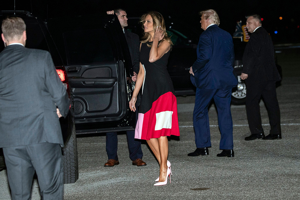 flotus, melania trump, novis dress, christian louboutin pumps, stilettos, pink heels, Donald Trump, Melania Trump. President Donald Trump, right, accompanied by first lady Melania Trump, walks on the tarmac after stepping off Air Force One at the Palm Beach International Airport, in West Palm Beach, FlaTrump, West Palm Beach, USA - 14 Feb 2020