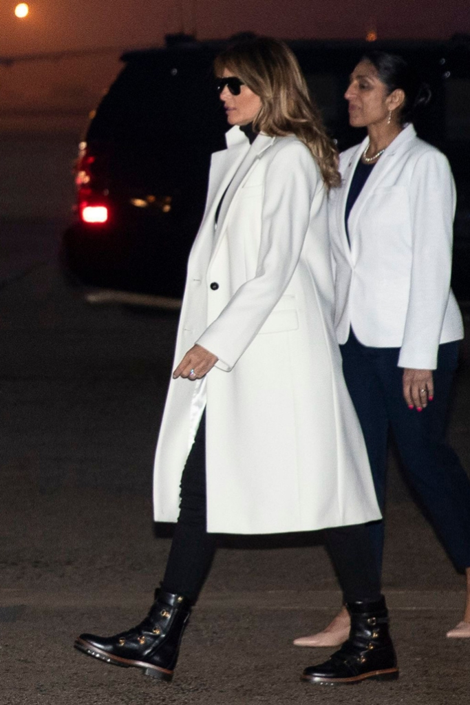 Melania Trump , andrews air force base, india state visit, white coat, dior wildior boots, combat boots, black skinny jeans, turtleneck, celebrity style, flotus