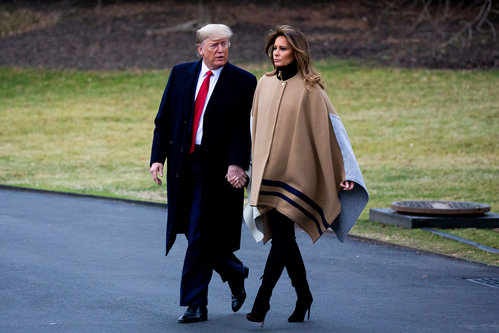 flotus, melania trump, chloe cape coat, black boots, stilettos, celebrity style, US President Donald J. Trump and First Lady Melania Trump depart the South Lawn of the White House for a weekend away at their Mar-a-Lago resort, in Washington, DC, USA, 31 January 2020.Donald and Melania Trump depart the White House, Washington, USA - 31 Jan 2020US President Donald J. Trump (L) and First Lady Melania Trump (R) walk across the South Lawn of the White House to depart by Marine One, in Washington, DC, USA, 31 January 2020. Trump departs for Mar-a-Lago for the weekend as the Senate reaches a critical stage of the impeachment trial and is poised to determine whether to include or reject witnesses and possibly proceed to a final vote on acquittal.US President Donald J. Trump departs the White House, Washington, USA - 31 Jan 2020