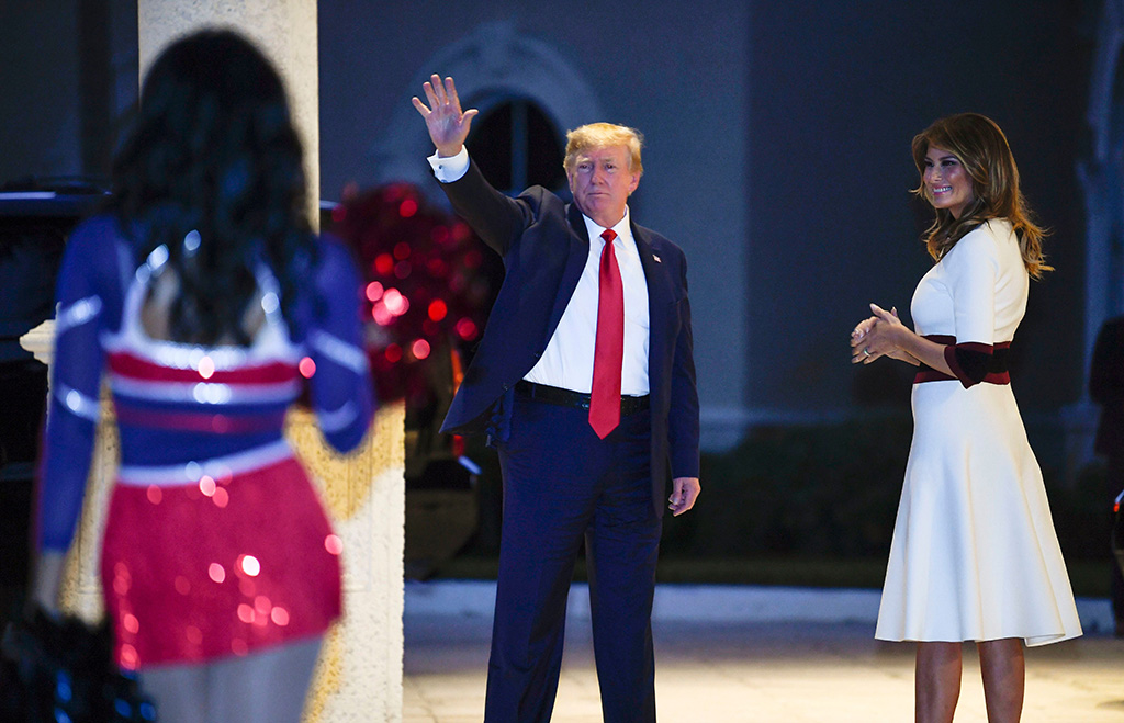 Donald Trump, Melania Trump. President Donald Trump and first lady Melania Trump watch as the Florida Atlantic University Marching Band performs during a Super Bowl party at the Trump International Golf Club in West Palm Beach, FlaTrump, West Palm Beach, USA - 02 Feb 2020