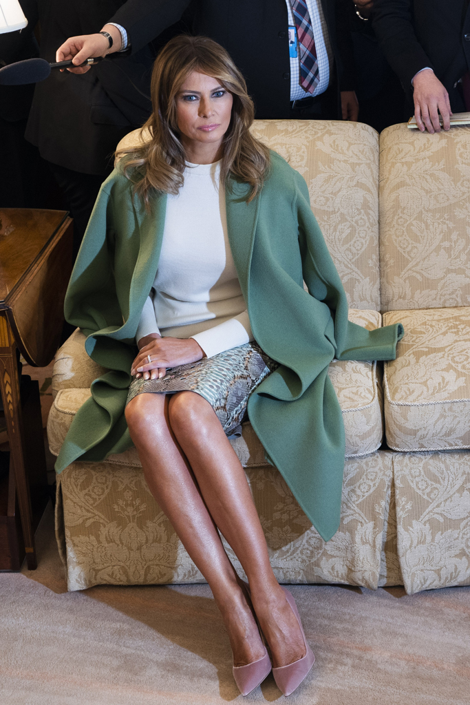 Melania Trump, white house, green coat, white top, python skirt, legs, pink pumps, first lady, february 2020