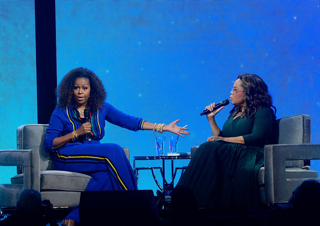 "michelle obama, elie saab, blue pantsuit, striped shirt, celebrity style, fashion, Oprah Winfrey, Michelle Obama. Michelle Obama, left, and Oprah Winfrey participate at ""Oprah's 2020 Vision: Your Life in Focus"" tour at the Barclays Center, in New YorkNY Oprah's 2020 Vision Tour, New York, USA - 07 Feb 2020"