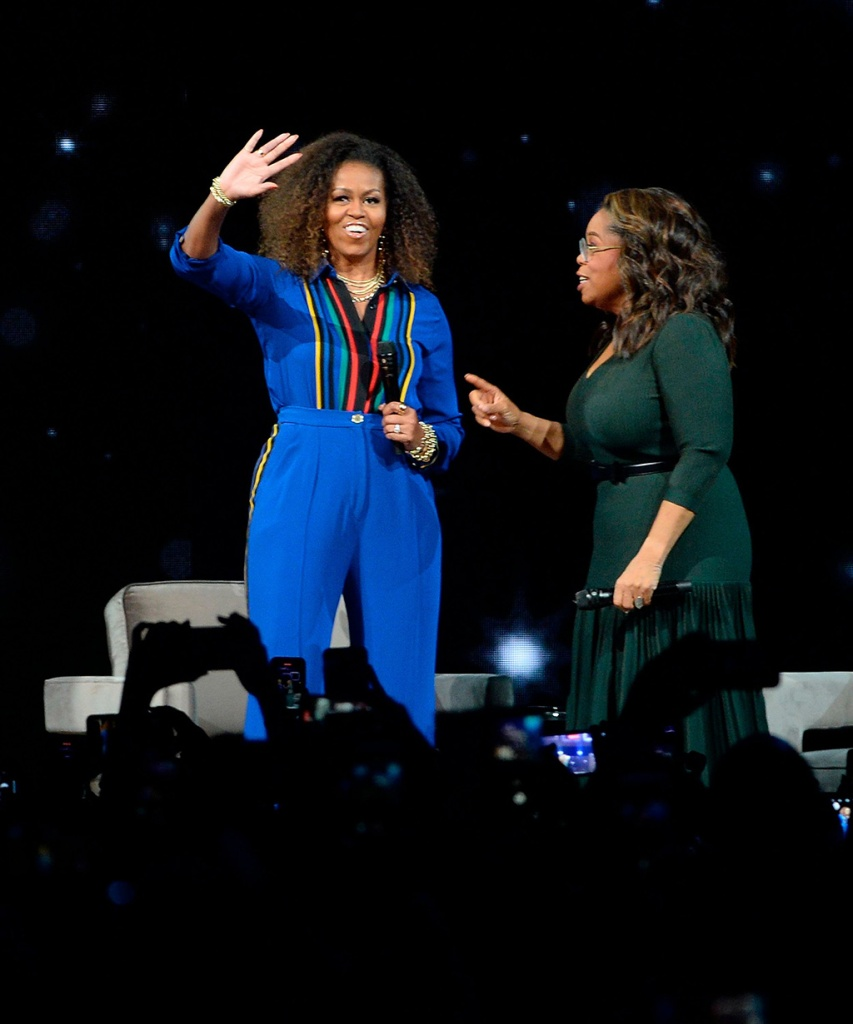 "michelle obama, elie saab, blue pantsuit, striped shirt, celebrity style, fashion, Oprah Winfrey, Michelle Obama. Michelle Obama, left, and Oprah Winfrey participate at ""Oprah's 2020 Vision: Your Life in Focus"" tour at the Barclays Center, in New YorkNY Oprah's 2020 Vision Tour, New York, USA - 07 Feb 2020Michelle Obama, Oprah Winfrey. Michelle Obama and Oprah Winfrey participates at ""Oprah's 2020 Vision: Your Life in Focus"" tour at the Barclays Center, in New YorkNY Oprah's 2020 Vision Tour, New York, USA - 07 Feb 2020"