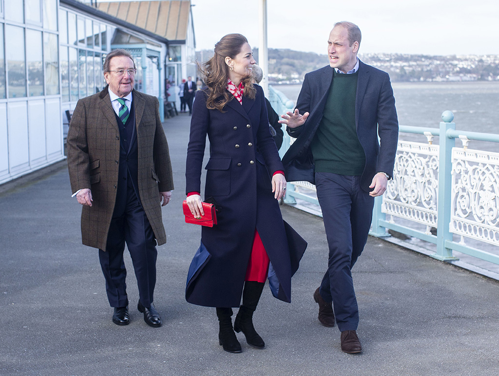 kate middleton, navy coat, red dress, black boots, celebrity style, royal fashion, Catherine Duchess of Cambridge and Prince William visit to RNLI Mumbles Lifeboat StationPrince William and Catherine Duchess of Cambridge visit to South Wales, UK - 04 Feb 2020