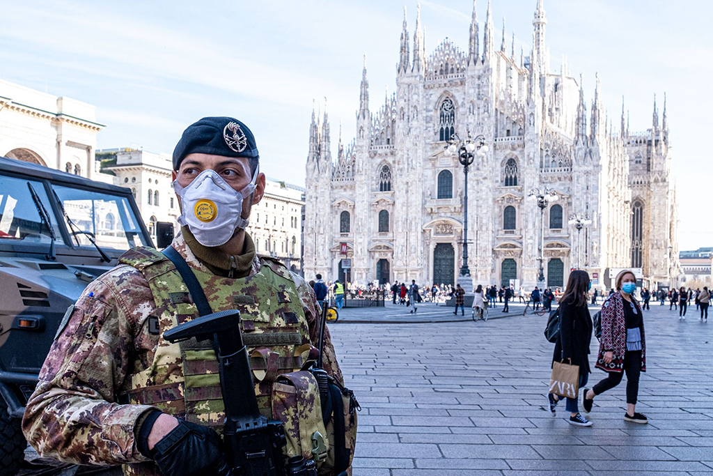 Military in Piazza Duomo wear the mask to protect themselves from the CoronaVirus COVID-19Coronavirus outbreak, Milan, Italy - 24 Feb 2020