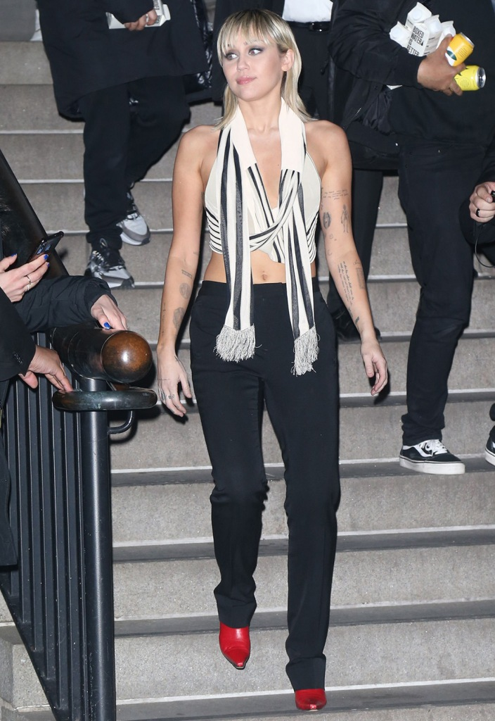 Miley Cyrus, halter scarf top, black and white top, red boots, black pants, Miley Cyrus out and about, New York Fashion Week, USA - 12 Feb 2020