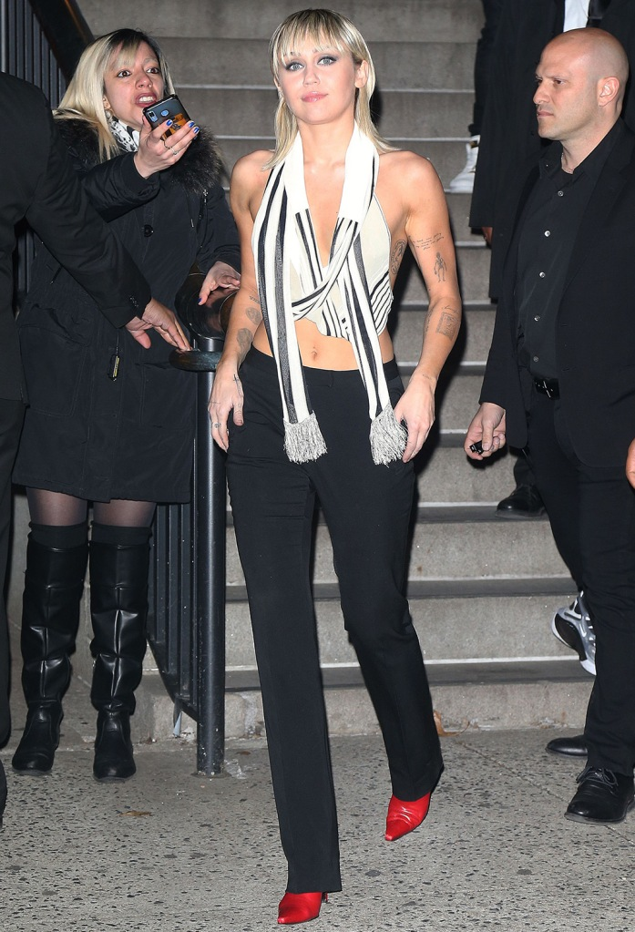 Miley Cyrus, abs, halter scarf top, black and white top, red boots, black pants, Miley Cyrus out and about, New York Fashion Week, USA - 12 Feb 2020