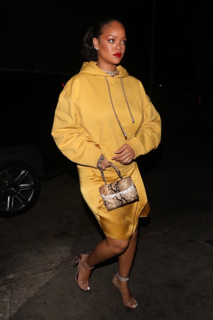 Rihanna, fenty, hoodie dress, yellow, mustard, snakeskin heels, strappy sandals, mini bag, satin skirt, sweatshirt, is seen arriving to The Nice Guy in a beautiful gold Oscar color dress. 11 Feb 2020 Pictured: Rihanna. Photo credit: iamKevinWong / PhotoGroup / MEGA TheMegaAgency.com +1 888 505 6342 (Mega Agency TagID: MEGA607459_014.jpg) [Photo via Mega Agency]