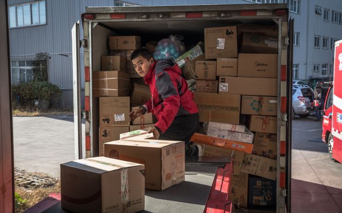 A man unloads packages at a delivery station for Chinese e-commerce giant JD.com on Singles' Day, in Beijing, China, 11 November 2019. Singles' Day is the largest online shopping festival in the world and Chinese consumers are expected to spend billions on bargains during the one-day e-commerce shopping spree.Singles' Day shopping frenzy begins in China, Beijing - 11 Nov 2019