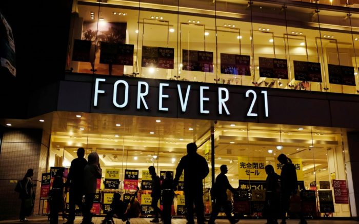 Shoppers walk by a Forever 21 clothing store, in Tokyo, as the liquidation sale signs are posted on the storefrontForever 21, Tokyo, Japan - 24 Oct 2019