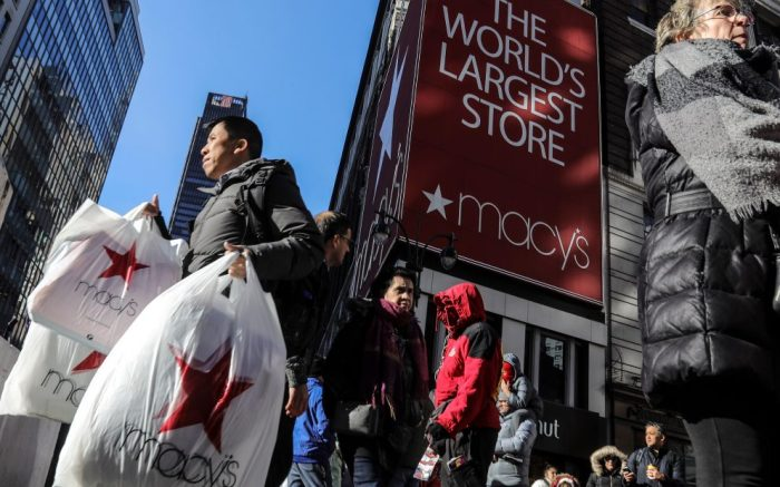 A shopper leaves Macy's department store with bags in both hands during Black Friday shopping, in New York. Black Friday shoppers fought for parking spots and traveled cross-state to their favorite malls, kicking off a shortened shopping season that intensified the mad scramble between Thanksgiving and ChristmasBlack Friday Shopping, New York, USA - 29 Nov 2019