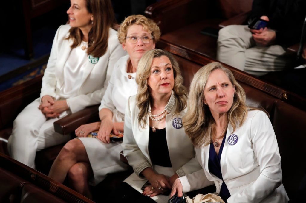 white outfits, congresswomen, Rep. Abigail Spanberger, D-Va., right, and others wait for President Donald Trump to deliver his State of the Union address to a joint session of Congress on Capitol Hill in WashingtonState of the Union, Washington, USA - 04 Feb 2020