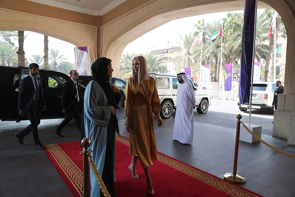 Ivanka Trump, yellow dress, clear heels, gianvito rossi pumps, center right, the daughter and senior adviser to U.S. President Donald Trump, is welcomed by Lamia Abdulaziz Khan, executive director of the Global Women's Forum, upon her arrival to deliver a keynote address at the Global Women's Forum in Dubai, United Arab EmiratesEmirates Ivanka Trump, Dubai, United Arab Emirates - 16 Feb 2020