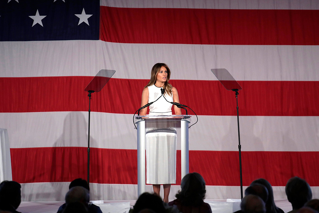 "flotus, melania trump, white dress, midi dress, First lady Melania Trump speaks at the Women of Distinction Luncheon hosted by Palm Beach Atlantic University, in Palm Beach, Fla. The university presented Trump with its ""Women of Distinction"" awardMelania Trump Speech, Palm Beach, USA - 19 Feb 2020"