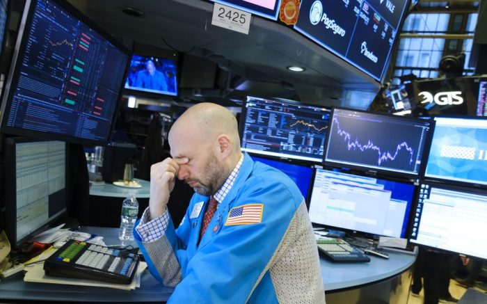 A trader rubs his eyes at the end of the day on the floor of the New York Stock Exchange in New York, New York, USA, 24 February 2020. Stocks around the world are broadly lower as investors are reportedly reacting to news that the coronavirus is spreading to more countries and the Dow Jones industrial average closed down over 1000 points.New York Stock Exchange, USA - 24 Feb 2020