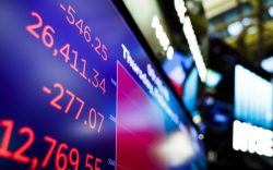A screen shows the Dow Jones