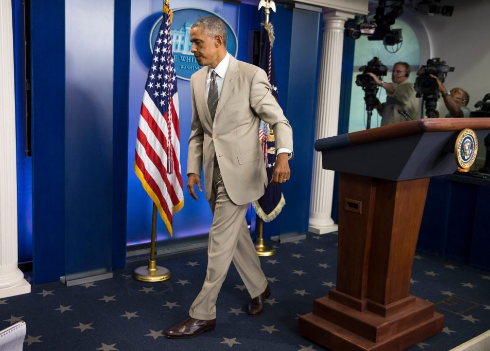 Barack Obama, tan suit, controversy, Barack Obama President Barack Obama leaves the James Brady Press Briefing Room of the White House in Washington, after speaking about the economy, Iraq, and Ukraine, before convening a meeting with his national security team on the militant threat in Syria and IraqObama, Washington, USA