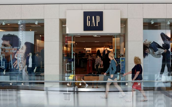 In this Aug. 31, 2017, photo, people walk by a Gap store in Pittsburgh. reports financial results on . The Gap Inc. reports financial results on Thursday, March 1, 2018Earns The Gap, Pittsburgh, USA - 31 Jul 2017