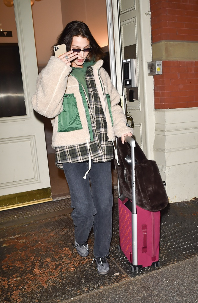 Bella Hadid, off-white x jordan 5 sneakers, layers, louis vuitton suitcase, fleece, plaid flannel, green hoodie, gray mom jeans, celebrity style, is seen leaving her apartment in New York to fly to London Fashion WeekPictured: Bella HadidRef: SPL5149303 160220 NON-EXCLUSIVEPicture by: New Media Images / SplashNews.comSplash News and PicturesLos Angeles: 310-821-2666New York: 212-619-2666London: +44 (0)20 7644 7656Berlin: +49 175 3764 166photodesk@splashnews.comWorld Rights