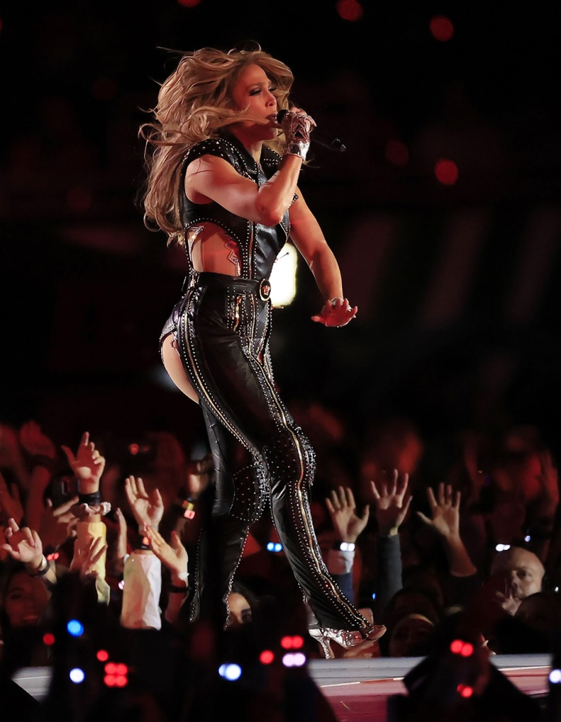 j-lo, versace, leather pantsuit, boots, US singer Jennifer Lopez performs during halftime of the National Football League's Super Bowl LIV at Hard Rock Stadium in Miami Gardens, Florida, USA, 02 February 2020.Super Bowl LIV, Miami Gardens, USA - 02 Feb 2020