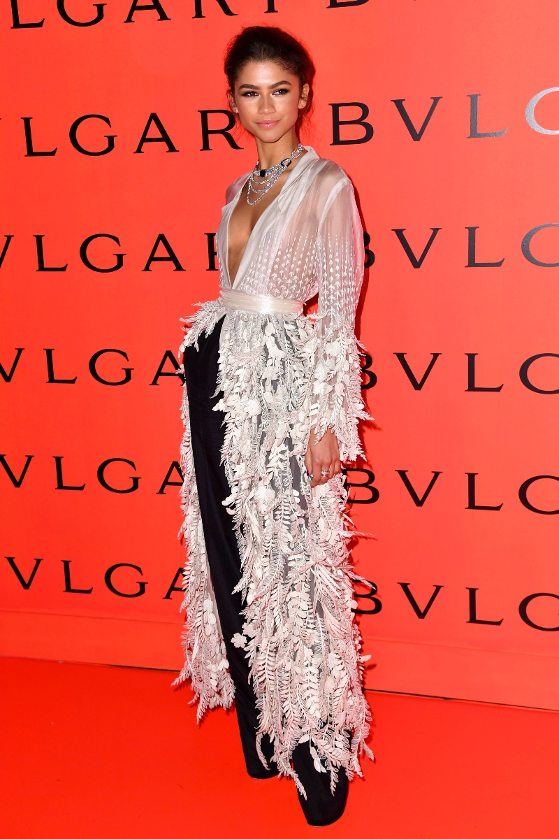 zendaya, white shirt, feathers, floral, black pants, bvlgari