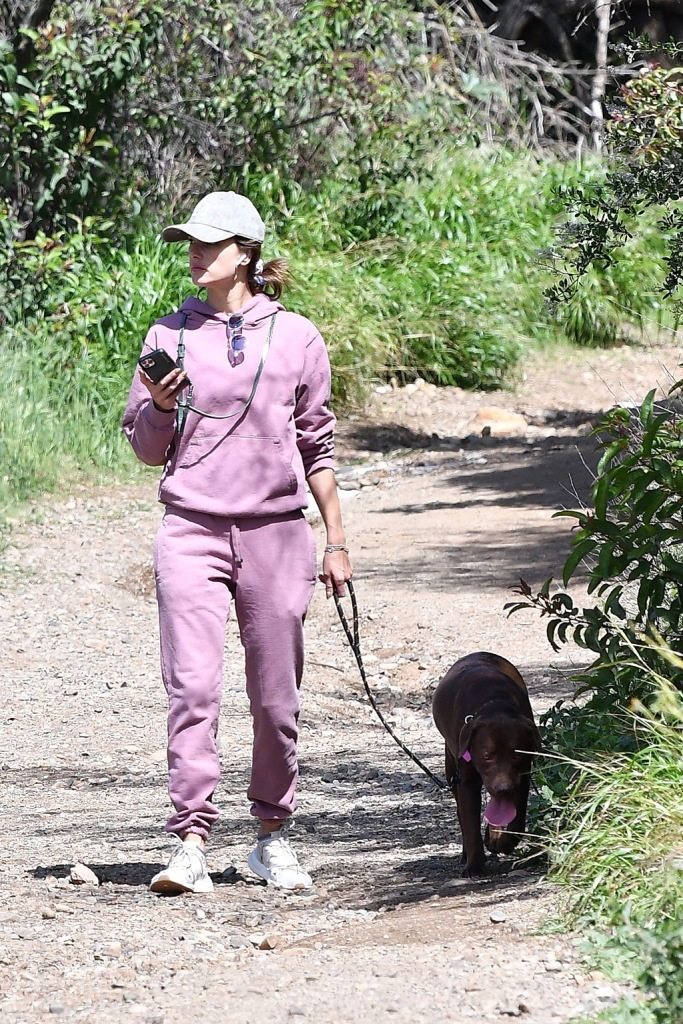 Alessandra Ambrosio, sweatsuit, sweatshirt, sweatpants, adidas arkyn, white sneakers, baseball cap, sunglasses, hiking with her dog. 18 Mar 2020 Pictured: Alessandra Ambrosio hiking with her dog. Photo credit: GG/MEGA TheMegaAgency.com +1 888 505 6342 (Mega Agency TagID: MEGA632165_008.jpg) [Photo via Mega Agency]