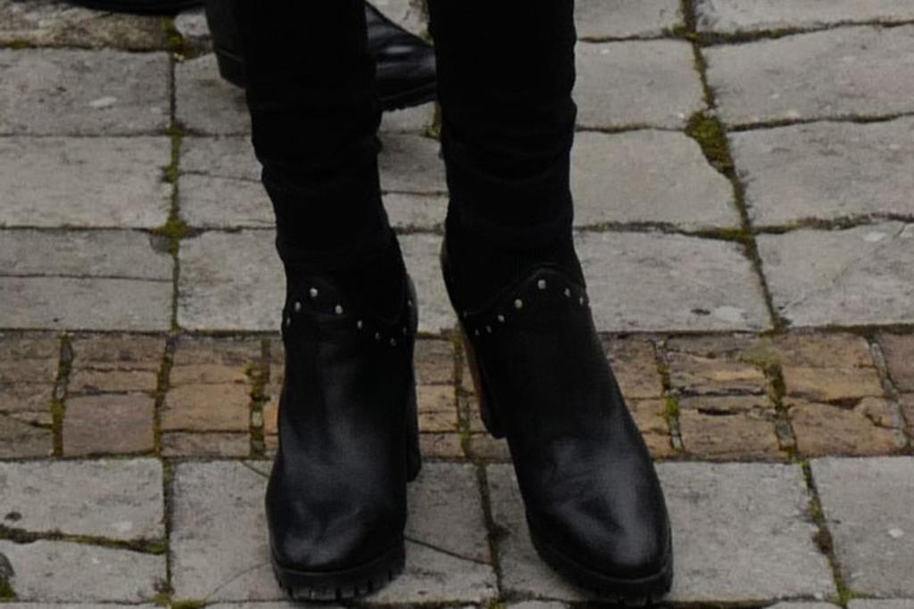Brigitte Macron, black boots, celebrity style, shoe detail, paris, france, march 2020