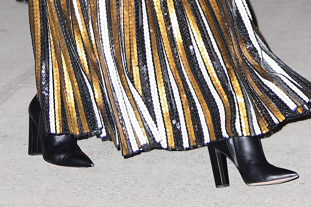 celine dion, proenza schouler, gold skirt, black shirt, black boots, leather, opera