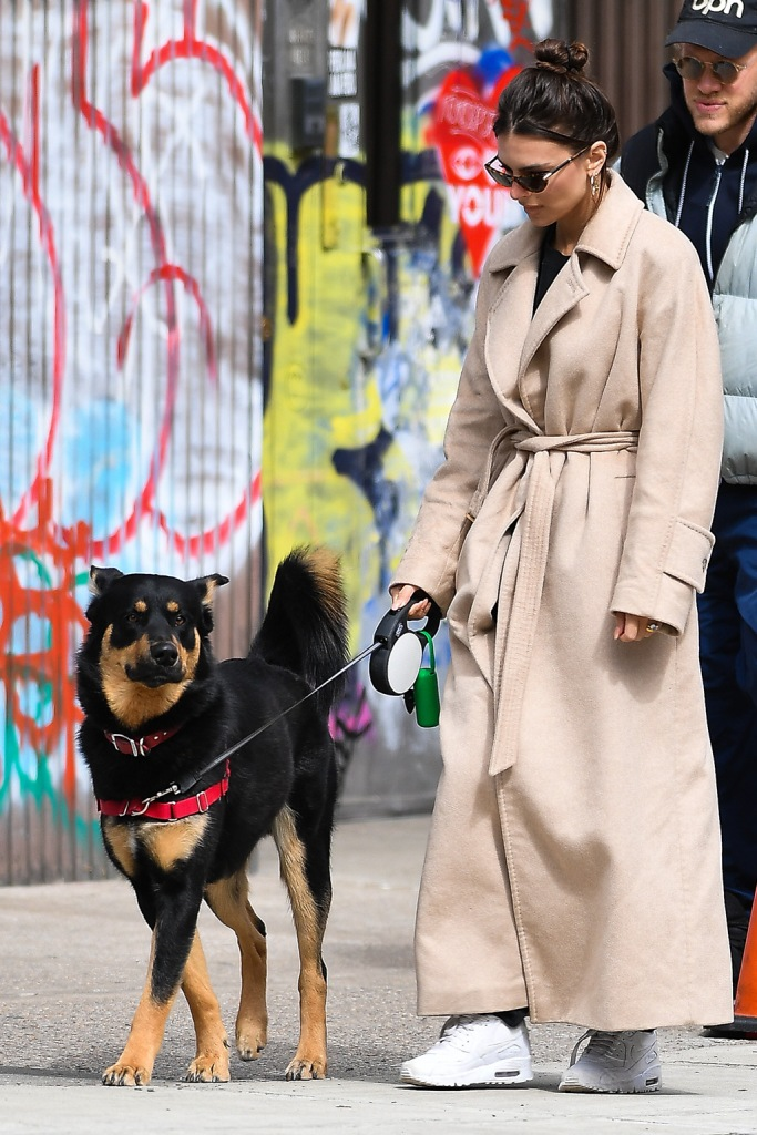 Emily Ratajkowski , cozy coat, beige coat, nike air max 90, white sneakers, and husband Sebastian Bear-McClard walk their dog Colombo in New York City.Emily was makeup free and looked downcast on the eve of Governor Cuomo shutting down New York City due to Coronavirus.Pictured: Emily Ratajkowski,Sebastian Bear-McClard,ColomboRef: SPL5158289 220320 NON-EXCLUSIVEPicture by: Robert O'Neil / SplashNews.comSplash News and PicturesLos Angeles: 310-821-2666New York: 212-619-2666London: +44 (0)20 7644 7656Berlin: +49 175 3764 166photodesk@splashnews.comWorld Rights