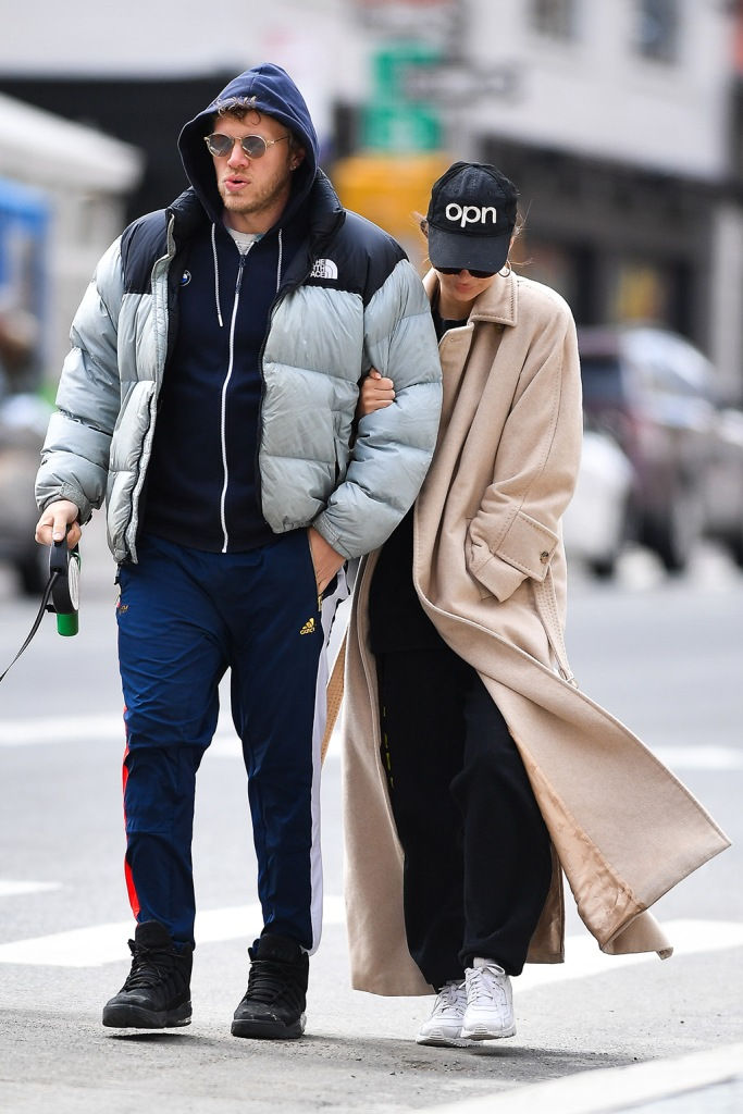 Emily Ratajkowski , emrata, beige coat, sweatpants, nike air max 90, white sneakers, celebrity fashion, street style, and husband Sebastian Bear-McClard walk their dog Colombo in New York City.Emily was makeup free and looked downcast on the eve of Governor Cuomo shutting down New York City due to Coronavirus.Pictured: Emily Ratajkowski,Sebastian Bear-McClard,ColomboRef: SPL5158289 220320 NON-EXCLUSIVEPicture by: Robert O'Neil / SplashNews.comSplash News and PicturesLos Angeles: 310-821-2666New York: 212-619-2666London: +44 (0)20 7644 7656Berlin: +49 175 3764 166photodesk@splashnews.comWorld Rights