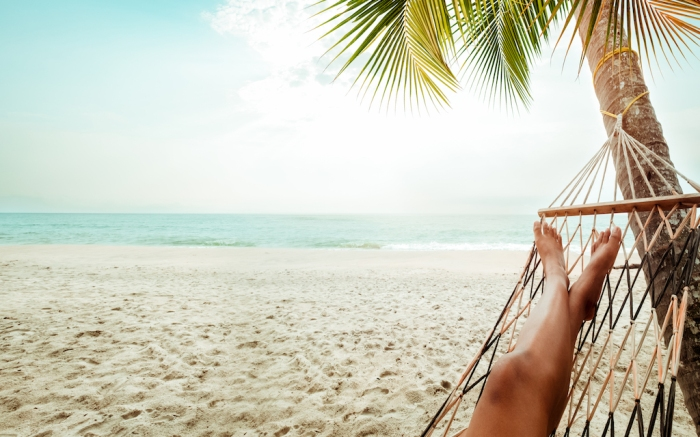 Leisure in summer - Beautiful Tanned legs of sexy women. relax on hammock at sandy tropical beach. vintage color styles; Shutterstock ID 603459827; Usage (Print, Web, Both): Web; Issue Date: 2/3