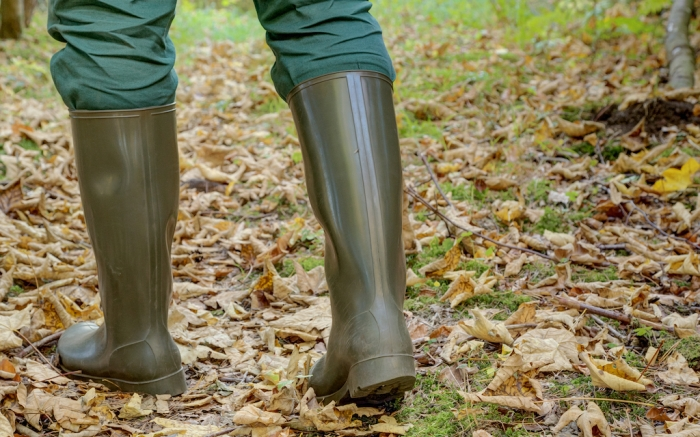 A man goes with rubber boots through the fallen leaves in the autumn forest. Rubber boots are the right footwear for outdoor activities in every terrain.; Shutterstock ID 1204346602; Usage (Print, Web, Both): Web; Issue Date: 2/3
