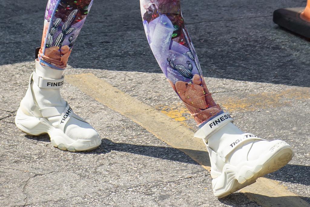 Slick Woods x The Kooples sneakers, j-lo, jennifer lopez, shoe detail, niyama sol leggings, miami, gym, celebrity fashion