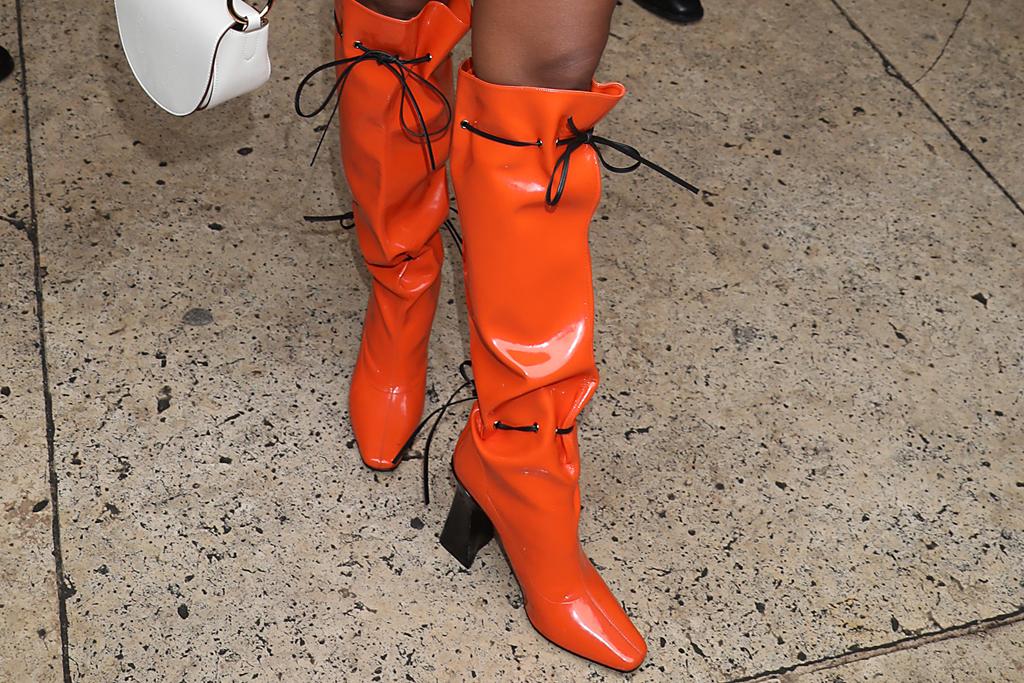 janelle monae, stella mccartney, orange, orange boots, purse, paris, pfw