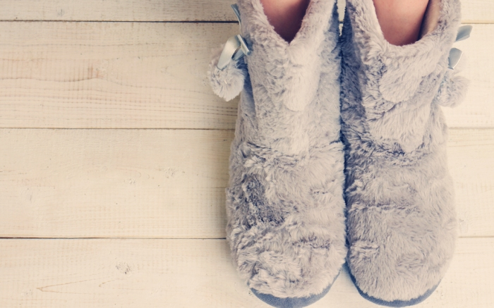 Woman wearing furry cozy boot slippers close up. Warmth concept. Winter clothes; Shutterstock ID 353868677; Usage (Print, Web, Both): Web; Issue Date: 2/3