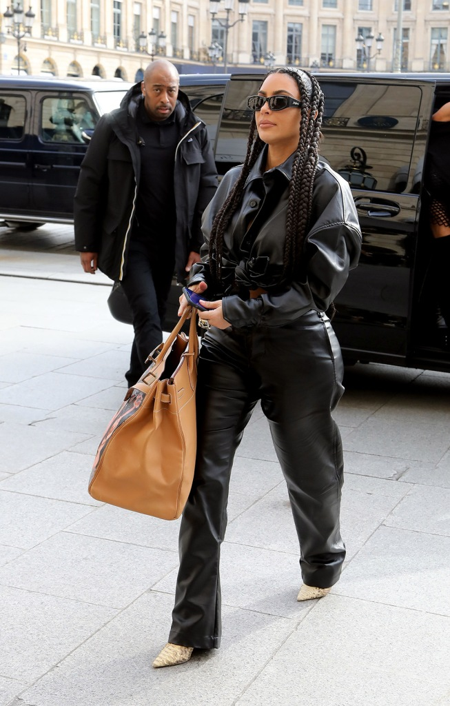 Kim Kardashian, leather outfit, crop top, trousers, hermes george condo bag, sunglasses, and Rick Owens' wife Michèle Lamy leave Palais de Tokyo and head back to Ritz Hotel during Paris Fashion Week. 03 Mar 2020 Pictured: Kim Kardashian. Photo credit: KCS Presse / MEGA TheMegaAgency.com +1 888 505 6342 (Mega Agency TagID: MEGA622992_021.jpg) [Photo via Mega Agency]
