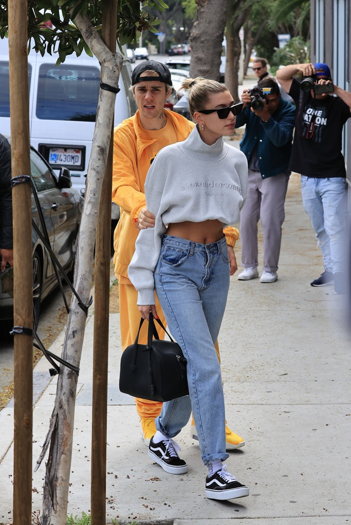 Justin Bieber, hailey baldwin, mom jeans, alexander wang shirt, vans sneakers, celebrity style, abs, heads to the spa with wife Hailey after his late night Birthday party. 01 Mar 2020 Pictured: Justin Bieber, Hailey Bieber. Photo credit: Rachpoot/MEGA TheMegaAgency.com +1 888 505 6342 (Mega Agency TagID: MEGA621882_001.jpg) [Photo via Mega Agency]