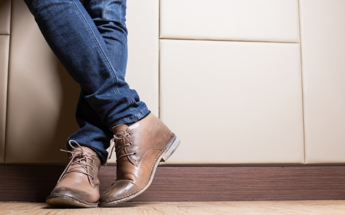 Young fashion man's legs in blue jeans and brown boots on wooden floor; Shutterstock ID 265942184; Usage (Print, Web, Both): Web; Issue Date: 2/3