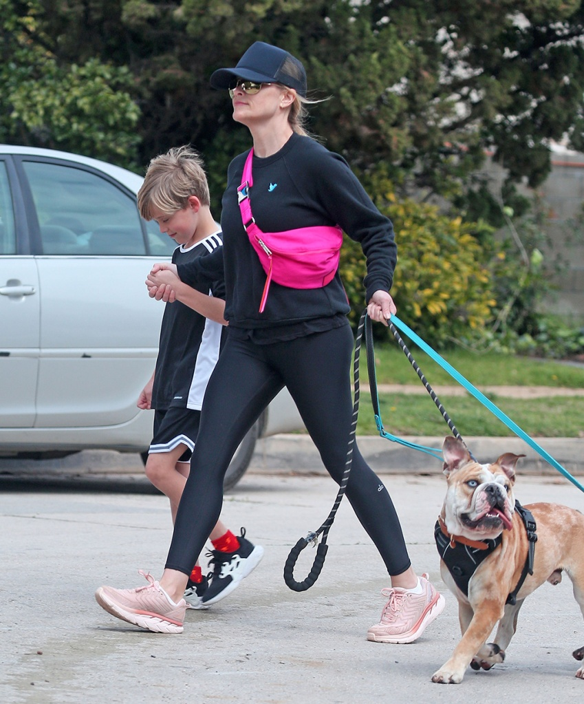 Reese Witherspoon, celebrity style, hot pink fanny pack, baseball cap, alo leggings, crewneck sweatshirt, outdoor voices x hoka one one sneakers, and Tennessee James TothReese Witherspoon out and about, Los Angeles, USA - 24 Mar 2020Reese Witherspoon and Tennessee James TothReese Witherspoon out and about, Los Angeles, USA - 24 Mar 2020