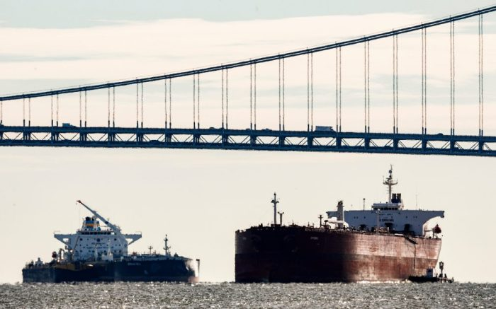 Cargo ships gather in New York harbor near the Verrazzano-Narrows Bridge in New York, New York, USA, 07 January 2019. The United States and China are scheduled to begin a first round of trade negotiations on 07 January in Beijing in an effort to settle the current trade dispute that is resulting in a 250 billion US dollar (217 billion euros) in tariffs on imported Chinese goods.Cargo ships in New York as Trade Negotiations Start Between US and China, USA - 07 Jan 2019