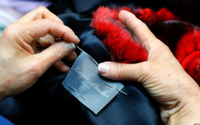 Seamstress Sonia Genao sews a Monique Lhuillier label in a coat at Pologeorgis Furs in New York. A burgeoning movement to outlaw fur is seeking to make its biggest statement yet in the fashion mecca of New York CityFur Ban, New York, USA - 10 Apr 2019