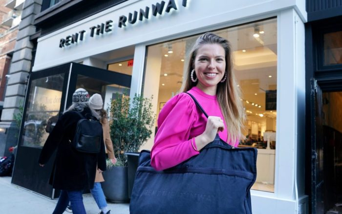 "Vara Pikor poses for a picture in front of a ""Rent The Runway"" store before returning some items in New York. Pikor is wearing some of the items she rents from the company, including her dress and earrings. Now a booming $1 billion business, the clothing rental sector is expected to reach $2.5 billion by 2023, says research firm GlobalData. But for traditional retailers, the economics of renting affordable clothing pose significant challengesClothing-Rentals, New York, USA - 25 Nov 2019"