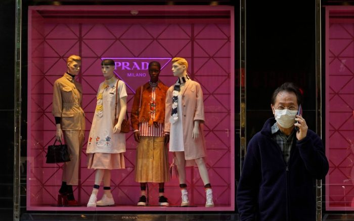A man wearing a face mask walks past a fashion shop in Hong Kong . COVID-19 viral illness has sickened tens of thousands of people in China since DecemberVirus Outbreak, Hong Kong, Hong Kong - 25 Feb 2020