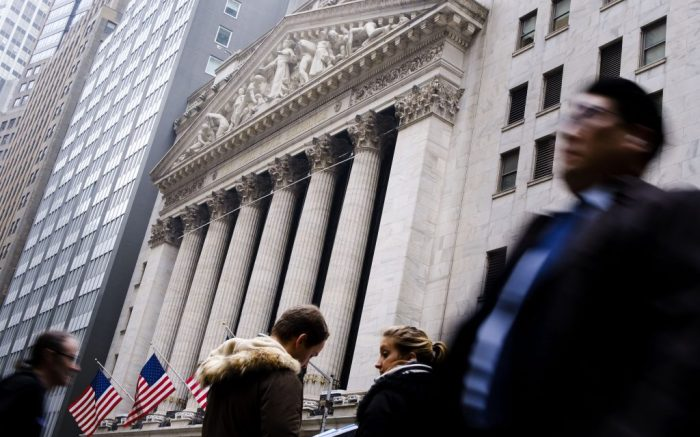 People walk past the New York Stock Exchange in New York, New York, USA, on 26 February 2020. Investors and financial markets around the world are continuing to gauge and assess the impact the coronavirus will have as it spreads around the world.New York Stock Exchange, USA - 26 Feb 2020