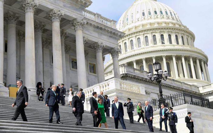 House Speaker Nancy Pelosi of Calif., in green, walks down the steps with Rep. Peter King, D-N.Y., Irish Prime Minister Leo Varadkar, and Rep. Richard Neal, D-Mass., following a lunch on Capitol Hill in WashingtonCongress US Ireland, Washington, United States - 12 Mar 2020