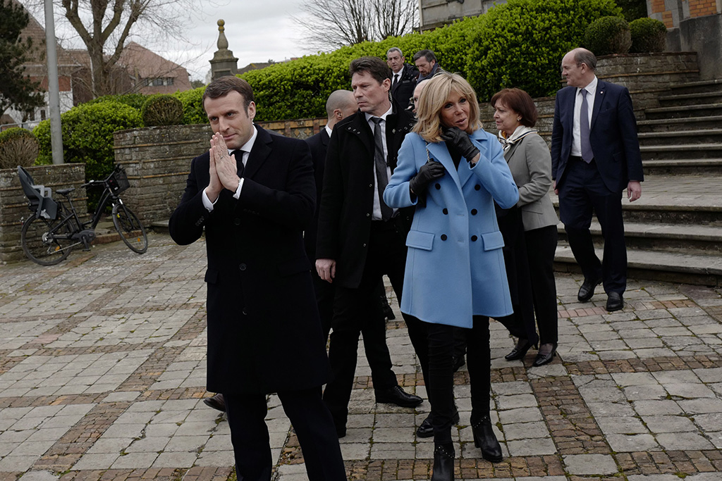 brigitte macron, skinny jeans, blue coat, black boots, celebrity style, French President Emmanuel Macron (L) and his wife Brigitte Macron (R) leave the polling station after casting his ballot in the first round French municipal elections in Le Touquet, France, 15 march 2020. France is holding nationwide elections to choose all of its mayors and other local leaders despite a crackdown on public gatherings because of the new Covid-19 coronavirus. Several European countries have closed borders, schools as well as public facilities, and have cancelled most major sports and entertainment events in order to prevent the spread of the SARS-CoV-2 coronavirus causing the Covid-19 disease.Municipal elections in France amid Covid-19 coronavirus outbreak, Le Touquet - 15 Mar 2020