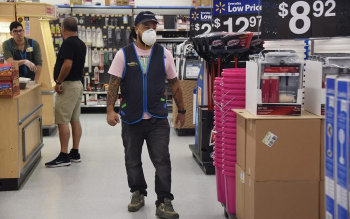 Walmart empoyee wearing a facial maskCoronavirus outbreak, Hallandale, Florida, USA - 15 Mar 2020 Stores running out of food, cleaning and papers supplies as shoppers fear the Coronavirus outbreak in Hallandale, Florida.