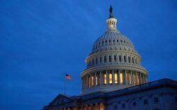 Light illuminates the U.S. Capitol dome